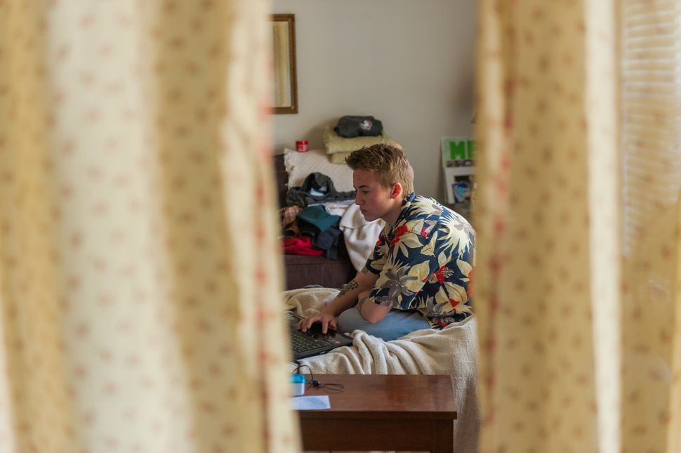 Preston Curts works on school work at his home in Ocala, Florida.