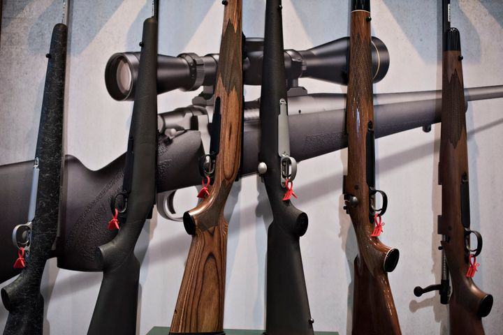 In this file photo from 2015, bolt action rifles sit on display in the Remington Arms Co. booth on the exhibition floor of th