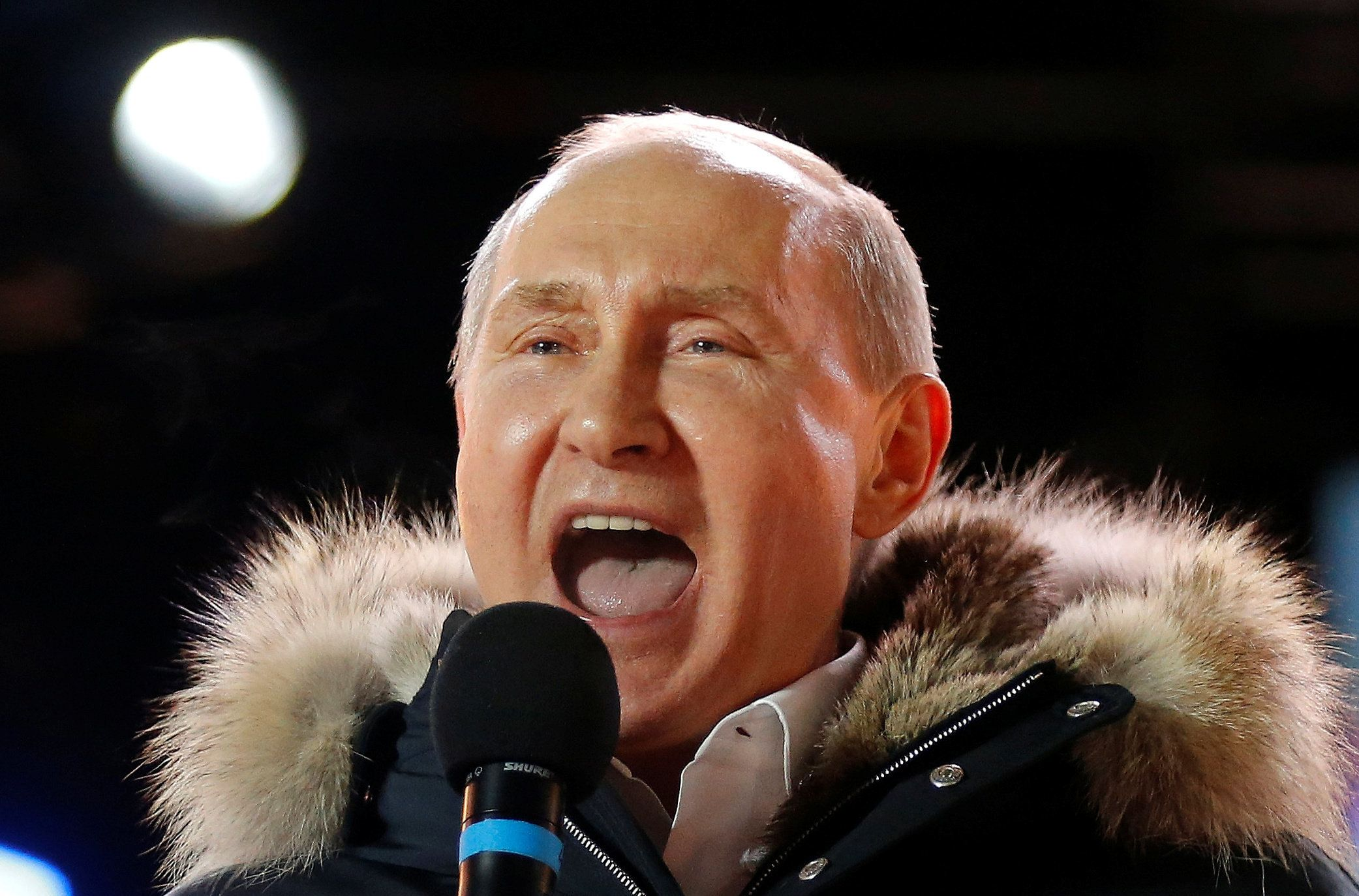 Russian President and Presidential candidate Vladimir Putin delivers a speech during a rally and concert marking the fourth anniversary of Russia's annexation of the Crimea region, at Manezhnaya Square in central Moscow, Russia March 18, 2018. Alexander Zemlianichenko/POOL via Reuters