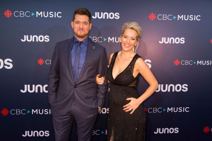 Michael Bublé and his wife, Luisana Lopilato,walk the red carpet at the 2018 Juno Awards.