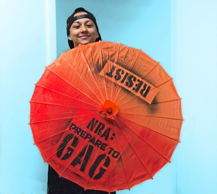 González with a parasol she was gifted by Gays Against Guns (GAG).