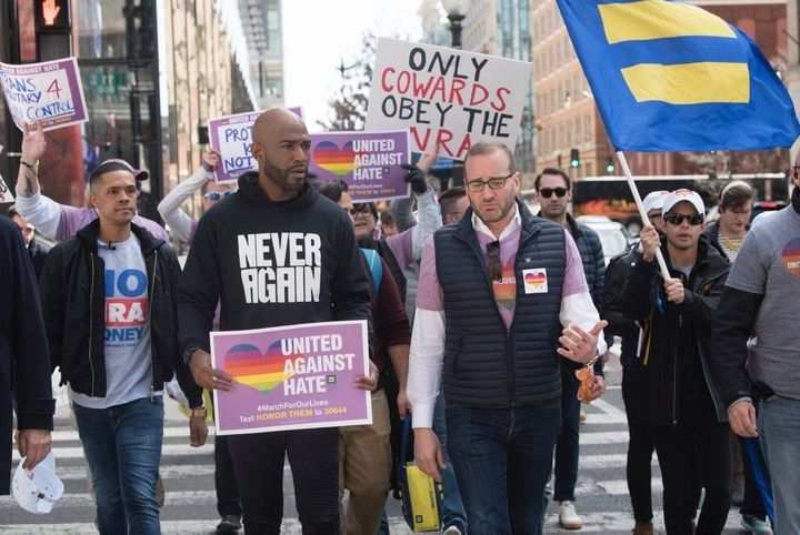 Karamo Brown, center, and Brandon Wolf march with the Human Rights Campaign on Saturday at the March for Our Lives in Washing