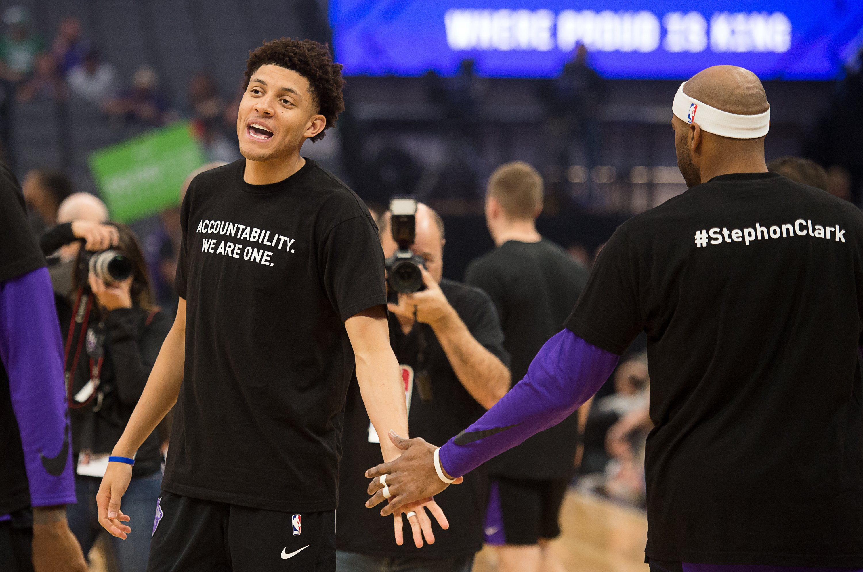 The Sacramento Kings' Justin Jackson and Vince Carter wear their Stephon Clark shirts during warmups.