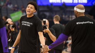 Sacramento Kings forward Justin Jackson (25) slaps hands with Sacramento Kings guard Vince Carter (15) as they wear T-shirts bearing the name of Stephon Clark during a game at Golden 1 Center on Sunday March 25, 2018 in Sacramento, Calif. The Kings and Celtics wore shirts bearing the name of the unarmed man, Stephon Clark, who was killed by Sacramento police. The black warm-up shirts have 'Accountability. We are One' on the front and 'Stephon Clark' on the back. (Paul Kitagaki Jr./Sacramento Bee/TNS via Getty Images)