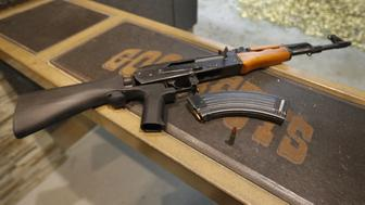OREM, UT - FEBRUARY 21: A 7,62X39mm round sits next a a 30 round magazine and an AK-47 with a bump stock installed at Good Guys Gun and Range on February 21, 2018 in Orem, Utah. The bump stock is a device when installed allows a semi-automatic to fire at a rapid rate much like a fully automatic gun. (Photo by George Frey/Getty Images)