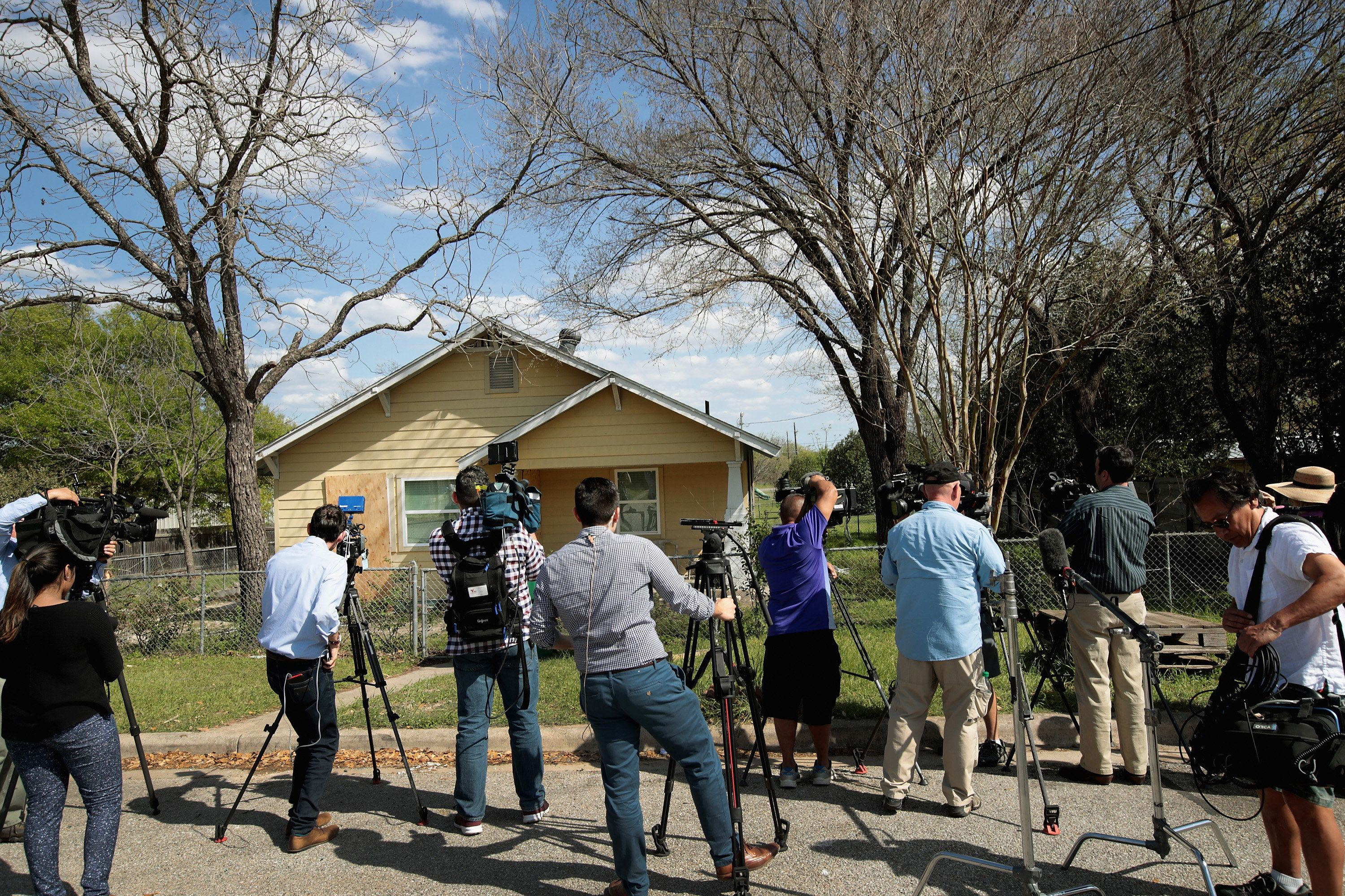 PFLUGERVILLE, TX - MARCH 22: Television news crews report from the front of the home of Mark Anthony Conditt following the police investigation at the property on March 22, 2018 in Pflugerville, Texas. Conditt, the 23-year-old suspect in the Austin package bombings, blew himself up inside his SUV as police tried to take him into custody yesterday in the nearby city of Round Rock. A massive search for the bomber had been underway by local and federal law enforcement officials in Austin and the surrounding area after several package bombs had detonated in recent weeks, killing two people and injuring several others. (Photo by Scott Olson/Getty Images)