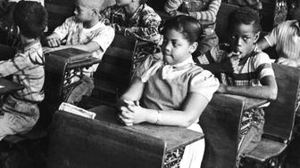 Vew of the interior of a classroom at the racially segregated Monroe Elementary School, Topeka, Kansas, March 1953. Among the students are Linda Brown (front row, right) and her sister Terry Lynn (far left row, third from front) who, with their parents, initiated the landmark Civil Rights lawsuit 'Brown V. Board of Education,' that led the way to the beginning of integration in the US education system. (Photo by Carl Iwasaki/The LIFE Images Collection/Getty Images)