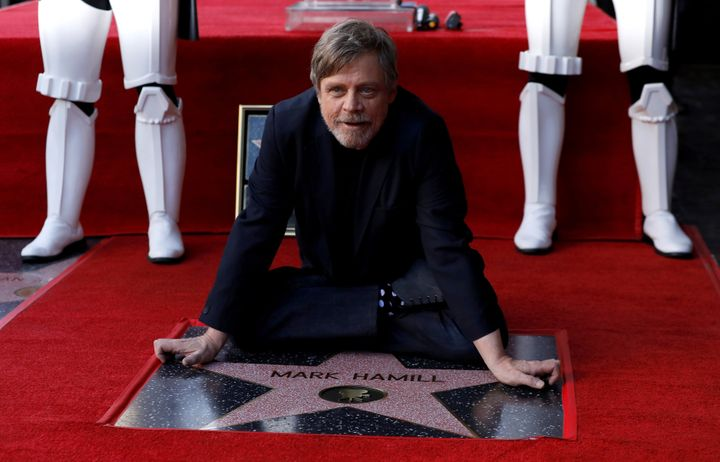Actor Mark Hamill poses on his star on the Hollywood Walk of Fame after it was unveiled on March 8.