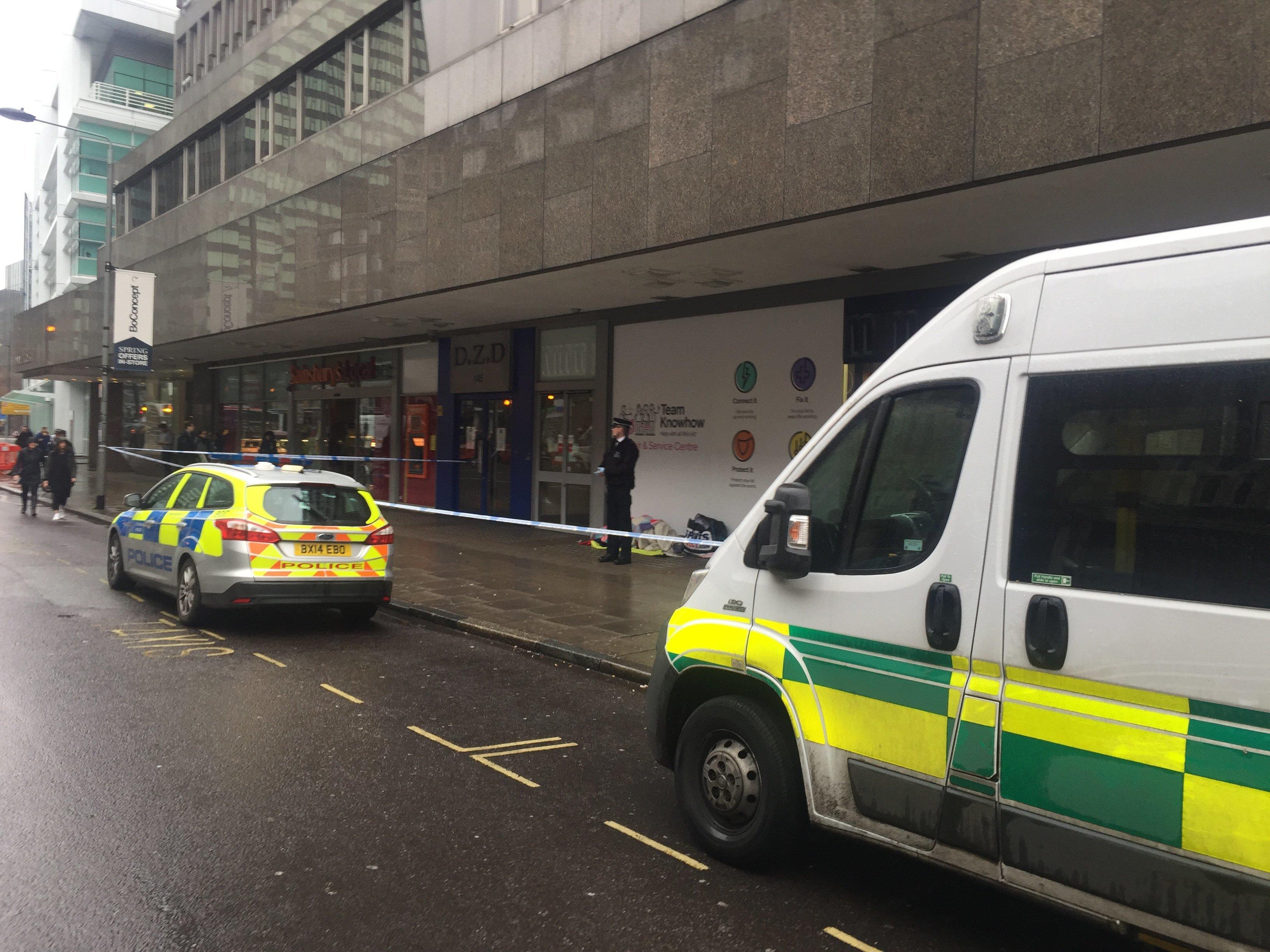 Police guard the body of arough sleeperwho diedon Tottenham Court Road overnight on