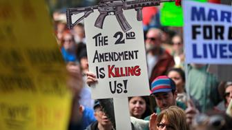 """Protestors hold signs during a """"March For Our Lives"""" demonstration demanding gun control in Sacramento, California, U.S. March 24, 2018.  REUTERS/Bob Strong"""