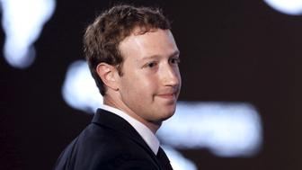 Facebook CEO Mark Zuckerberg asks a question during the II CEO Summit of the Americas on the sidelines of the VII Summit of the Americas in Panama City April 10, 2015. REUTERS/Carlos Garcia Rawlins