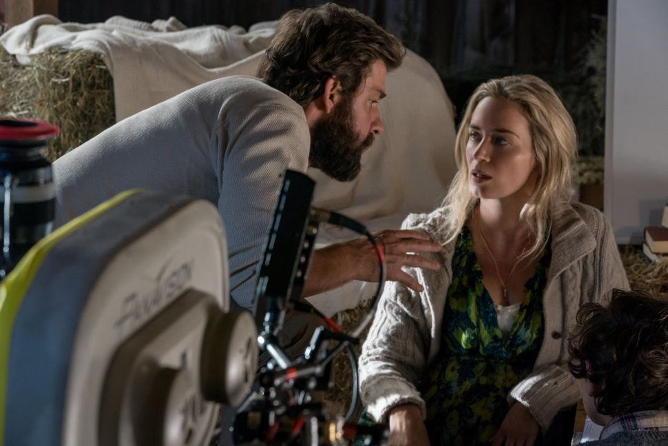 "John Krasinski directs Emily Blunt and Noah Jupe on the set of ""A Quiet Place."""