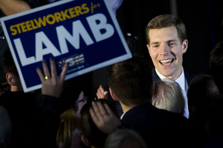 Democrat Conor Lamb greets supporters on the night of his upset victory in a congressional race in Pennsylvania.