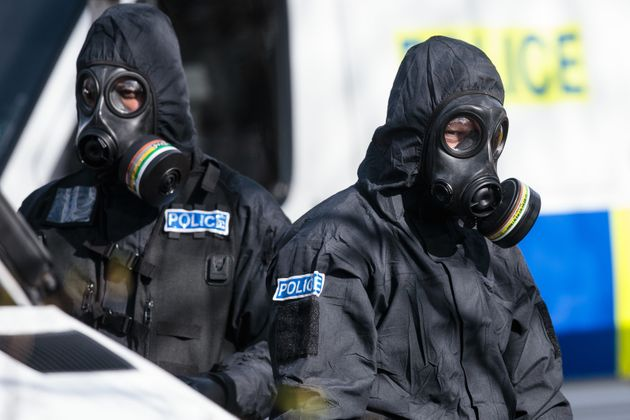 Police in protective suits in