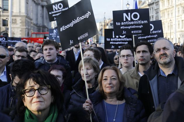 Members of the Jewish community hold a protest against Britain's opposition Labour party leader Jeremy...