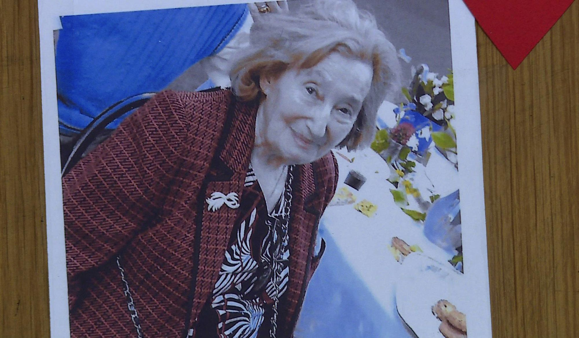 This AFP TV video frame grab shows a picture of Mireille Knoll posted on the door of her apartment in Paris on March 27, 2018 after she was found dead in her apartment on March 23 by firefighters called to extinguish a blaze. Two people have been charged with the murder of an 85-year-old French Jewish woman, who was stabbed and whose body was then set alight in a crime being treated as anti-Semitic, a judicial source said on March 27, 2018.  / AFP PHOTO / Laetitia PERON        (Photo credit should read LAETITIA PERON/AFP/Getty Images)