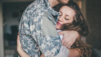 Very touching and sad scenes of young couple, husband goes out to war, woman is inconsolable.