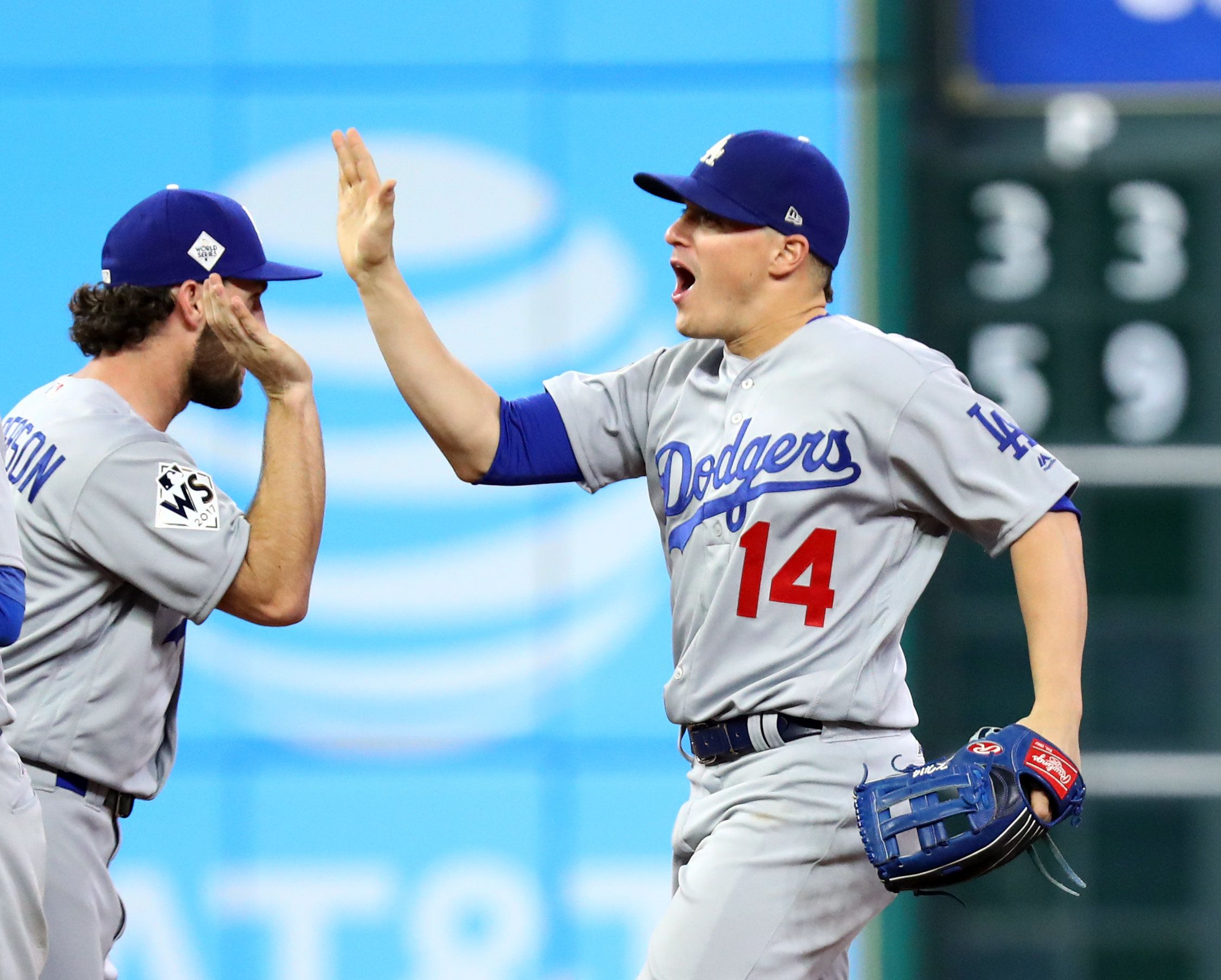 HOUSTON, TX - OCTOBER 28:  Enrique Hernandez #14 of the Los Angeles Dodgers celebrates with teammates after Game 4 of the 2017 World Series against the Houston Astros at Minute Maid Park on Saturday, October 28, 2017 in Houston, Texas. The Dodgers defeated the Astros 6-2. (Photo by Alex Trautwig/MLB Photos via Getty Images)