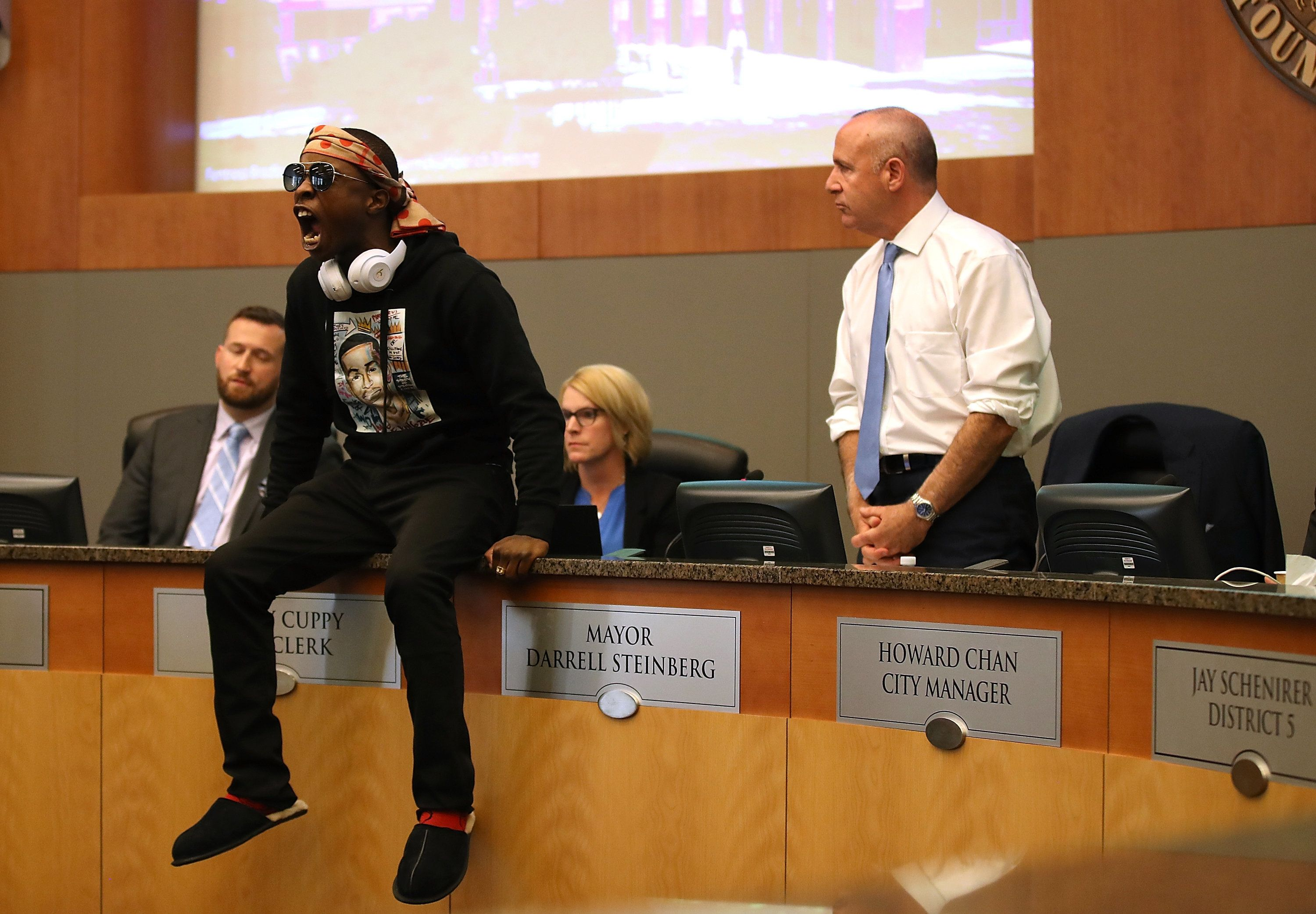 Stevante Clark, brother of Stephon Clark, disrupts a special city council meeting meeting at Sacramento City Hall on March 27
