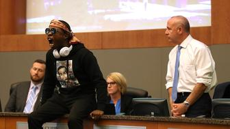 SACRAMENTO, CA - MARCH 27:  Stevante Clark, brother of Stephon Clark, disrupts a special city council meeting meeting at Sacramento City Hall on March 27, 2018 in Sacramento, California. Hundreds packed a special city council meeting at Sacramento City Hall to address concerns over the shooting death of Stephon Clark by Sacramento police.  (Photo by Justin Sullivan/Getty Images)