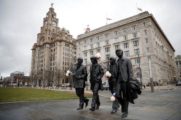 A statue of The Beatles sporting Ken Dodd's famous 'tickling