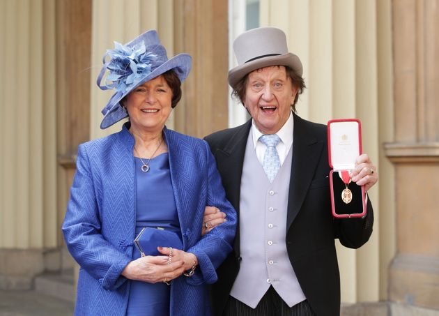 Sir Ken, with his partner, Anne Jones, at Buckingham Palace after he was made a Knight Bachelor of the...