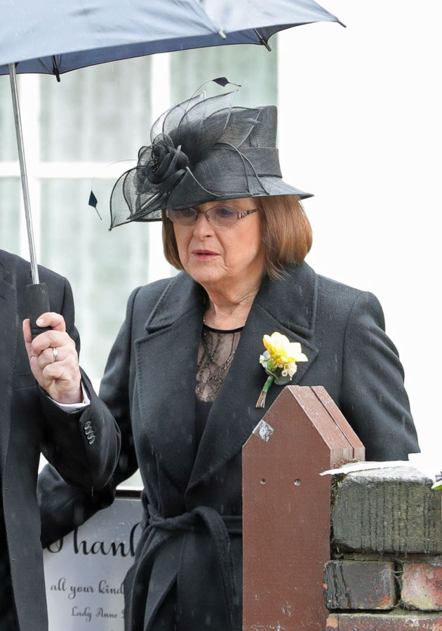 Sir Ken's wife, Anne, leaves their home in Knotty Ash ahead of his funeral at Liverpool