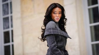 PARIS, FRANCE - FEBRUARY 27:  Winnie Harlow wears a gray wool turtleneck, a checked pattern dress, outside Dior, during Paris Fashion Week Womenswear Fall/Winter 2018/2019, on February 27, 2018 in Paris, France.  (Photo by Edward Berthelot/Getty Images)