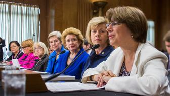 Women senators testify during a Senate Foreign Relations sub-committee hearing on 'Combating Violence and Discrimination Against Women: A Global Call to Action' on Capitol Hill in Washington . From right are Senators Amy Klobuchar,Tammy Baldwin, Debbie Stabenow, Elizabeth Warren, Patty Murray, Heidi Heitkamp, and Mazie K. Hirono. (Photo by Brooks Kraft LLC/Corbis via Getty Images)