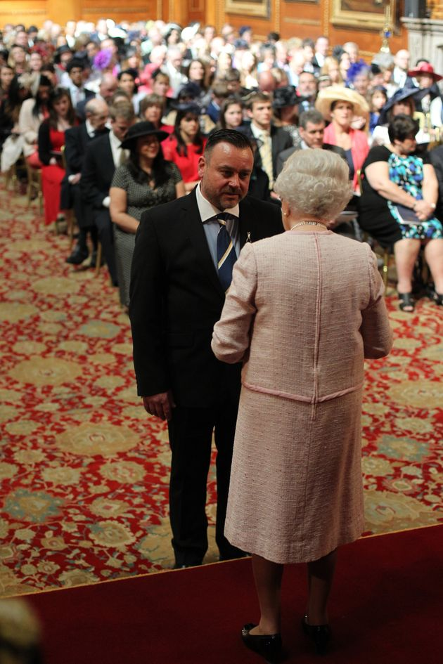 Nick receiving his MBE in