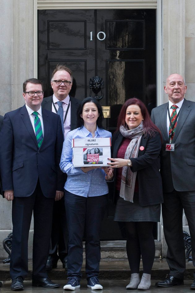 Partners Amanda McGurk (centre left) and Cara McCann (centre right) with Labour MP Conor McGinn (left)...