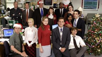 THE OFFICE -- 'A Benihana Christmas' Episode 9 -- Aired 12/14/06 -- Pictured: Back Row (l-r), Creed Bratton as Creed, Paul Liberstein as Toby, Brian Baumgartner as Kevin Malone, Kate Flannery as Meredith Palmer, Leslie David Baker as Stanley Hudson, Phyllis Smith as Phyllis Lapin, Mindy Kaling as Kelly Kapoor, B.J. Novak as Ryan Howard, Front Row (l-r) Rainn WIlson as Dwight Schrute, Angela Kinsey as Angela Martin, Jenna Fischer as Pam Beesly, Steve Carell as Michael Scott, John Krasinski as Jim Halpert  (Photo by Paul Drinkwater/NBC/NBCU Photo Bank via Getty Images)