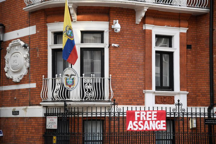 A sign is pinned to the railings outside the Ecuadorean embassy in central London as Wikileaks founder Julian Assange goes to