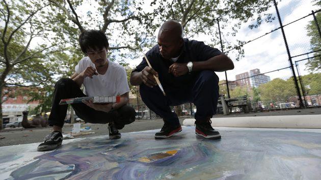 Milo and artist Pairoj Pichetmetakul put the finishing touches on Milo's