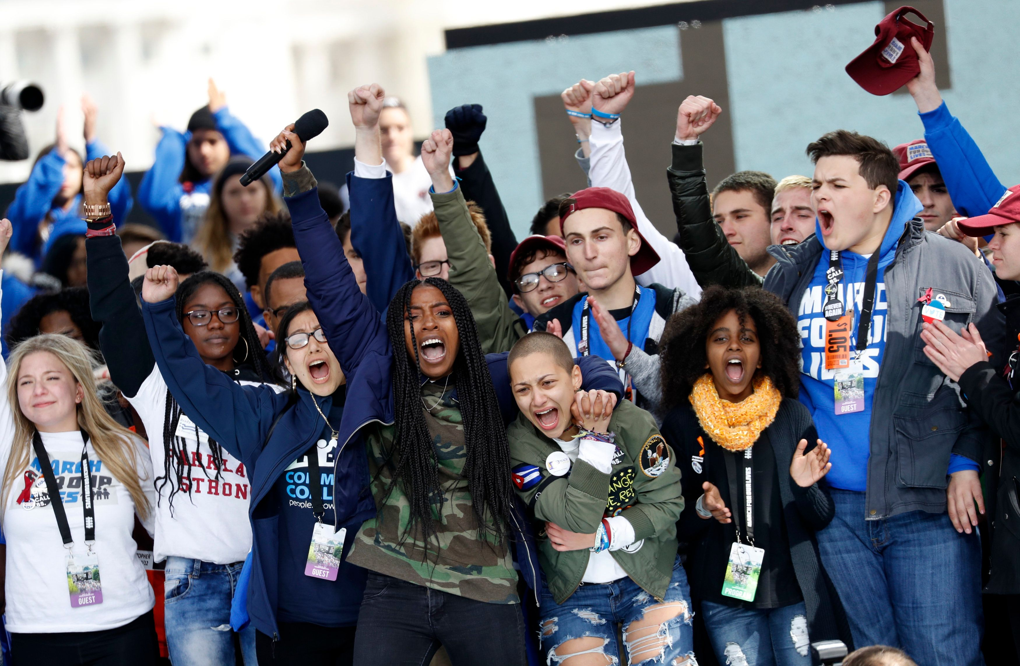 """Shooting survivors Tyra Hemans (center, L) and Emma Gonzalez (3rd from R), from Marjory Stoneman Douglas High School in Parkland, Florida, lead the cheers along with 11-year-old Naomi Wadler of Alexandria, Virginia (2nd R) at the conclusion of the """"March for Our Lives"""" event demanding gun control after recent school shootings at a rally in Washington, U.S., March 24, 2018. REUTERS/Aaron P. Bernstein"""