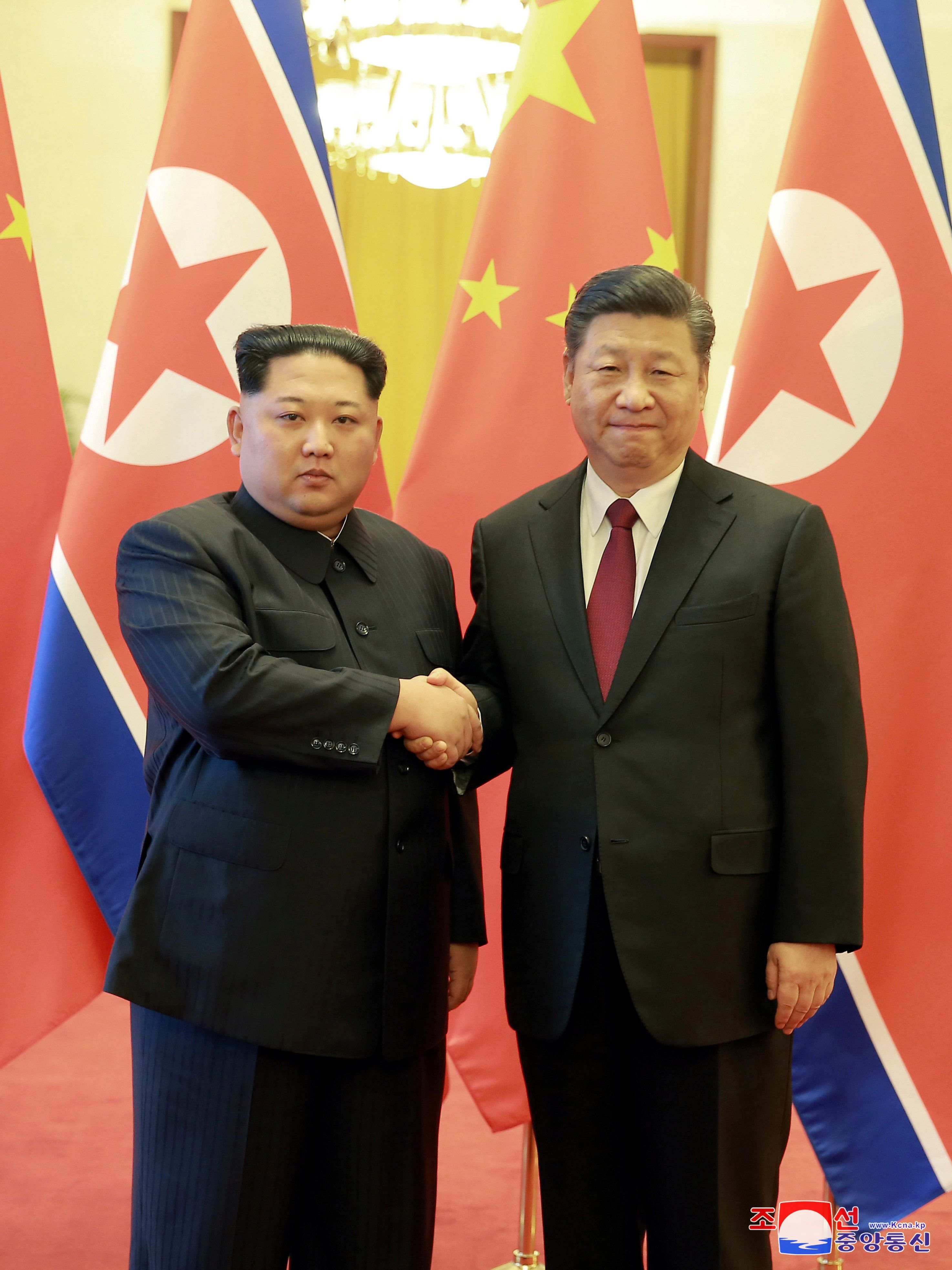 North Korean leader Kim Jong Un shakes hands with Chinese President Xi Jinping as he paid an unofficial visit to Beijing, China, in this undated photo released by North Korea's Korean Central News Agency (KCNA) in Pyongyang March 28, 2018. KCNA/via Reuters ATTENTION EDITORS - THIS IMAGE WAS PROVIDED BY A THIRD PARTY. REUTERS IS UNABLE TO INDEPENDENTLY VERIFY THIS IMAGE. NO THIRD PARTY SALES. NOT FOR USE BY REUTERS THIRD PARTY DISTRIBUTORS. SOUTH KOREA OUT. NO COMMERCIAL OR EDITORIAL SALES IN SOUTH KOREA.