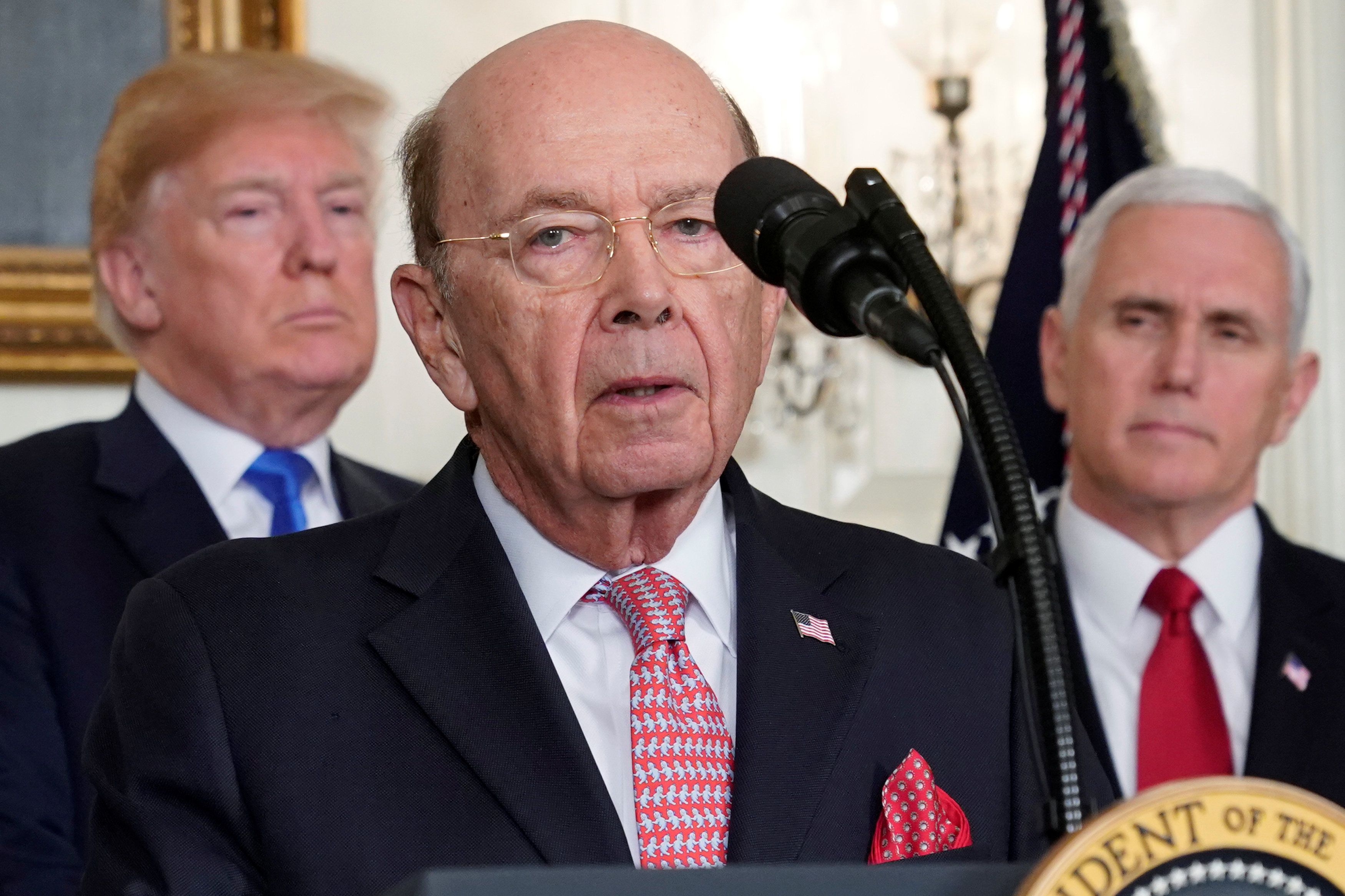U.S. President Donald Trump, flanked by ?Vice President Mike Pence?, listens to remarks by Commerce Secretary Wilbur Ross before signing a memorandum on intellectual property tariffs on high-tech goods from China, at the White House in Washington, U.S. March 22, 2018.  REUTERS/Jonathan Ernst