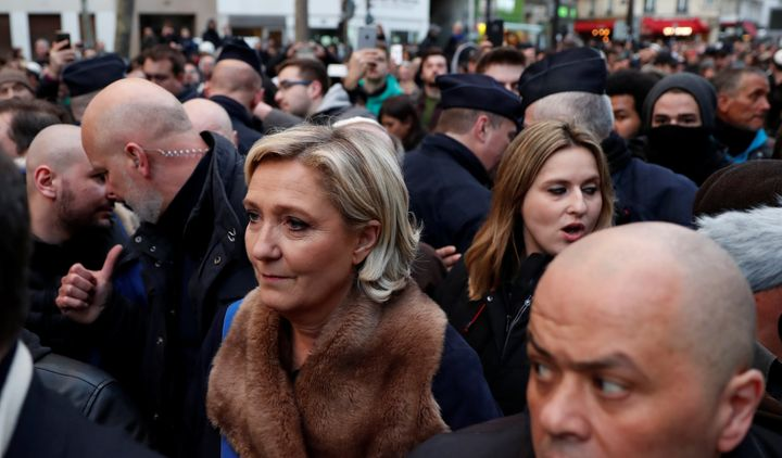 Marine Le Pen, leader of the France's far-right party, attends the march in spite of calls for her to not come.