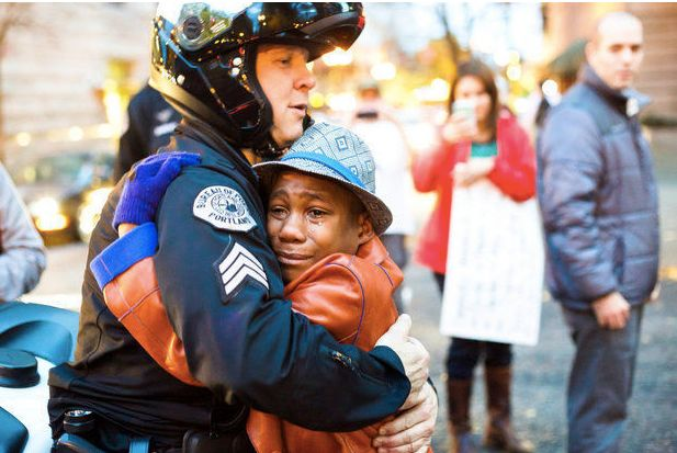 The viral moment when Devonte Hart and a police officer hugged at a demonstration.