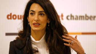 Lawyer Amal Clooney speaks during a news conference for Mohamed Nasheed, in central London, Britain October 5, 2015. Lawyers working to release the jailed former President of the Maldives Nasheed are seeking travel bans and targeted financial sanctions against top Maldivian officials as they step up efforts to free the islands' first democratically elected leader.  REUTERS/Peter Nicholls