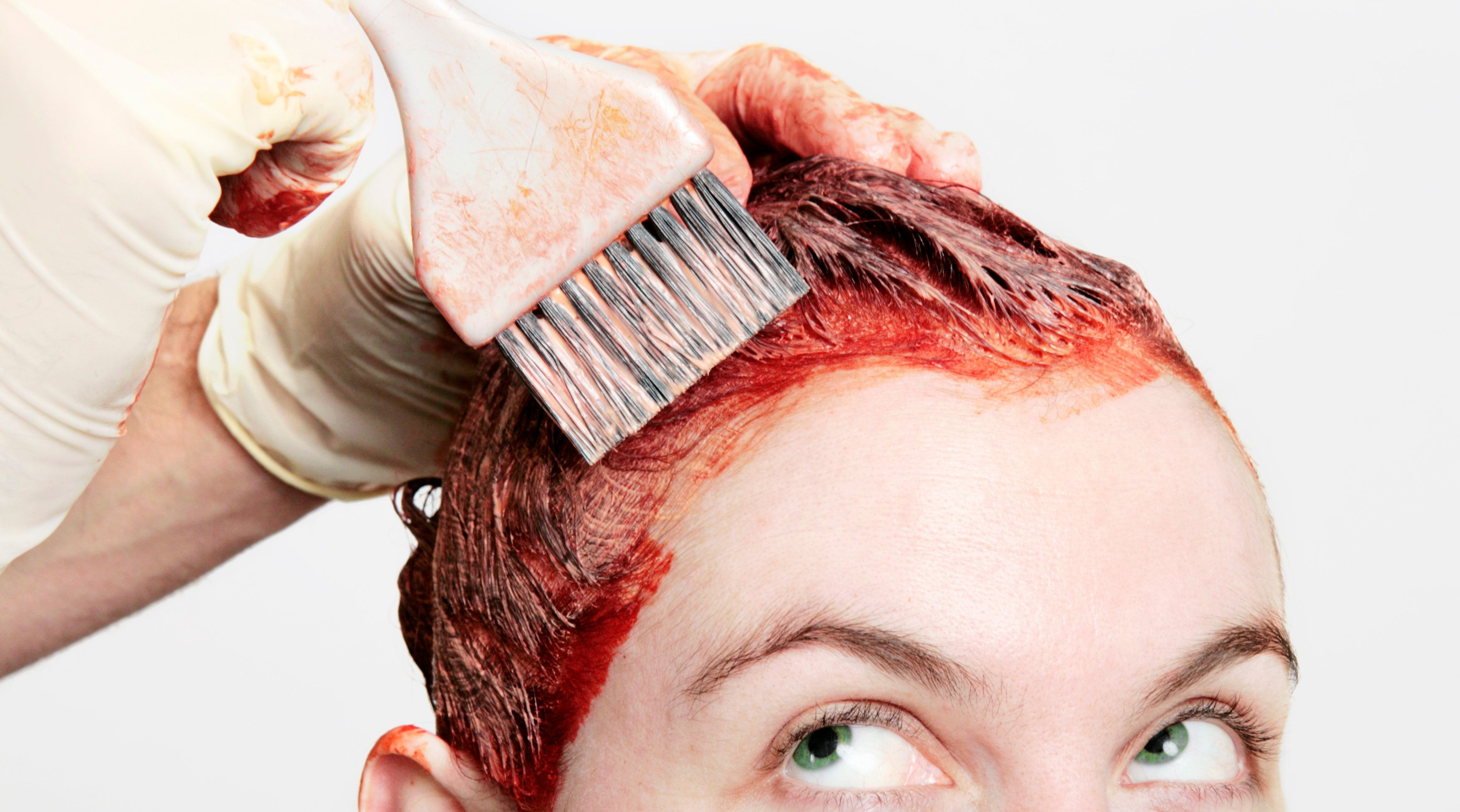 Permanent hair dye being applied with a watchful eye.