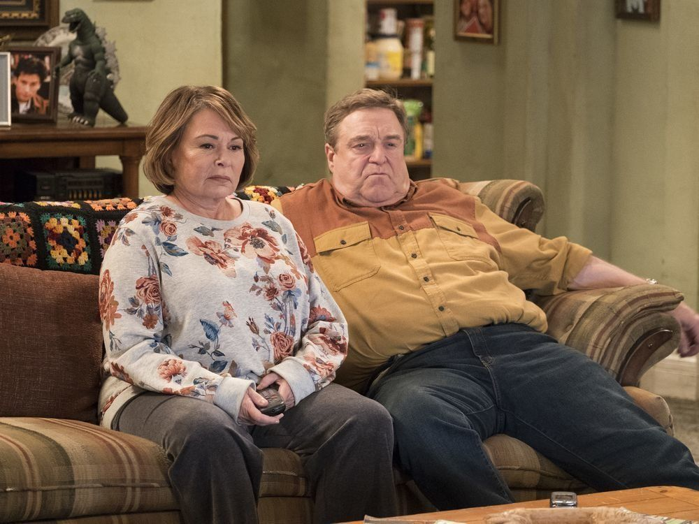 "In this image released by ABC, Roseanne Barr, left, and John Goodman appear in a scene from the reboot of ""Roseanne,"" premiering on Tuesday at 8 p.m. EST. (Adam Rose/ABC via AP)"