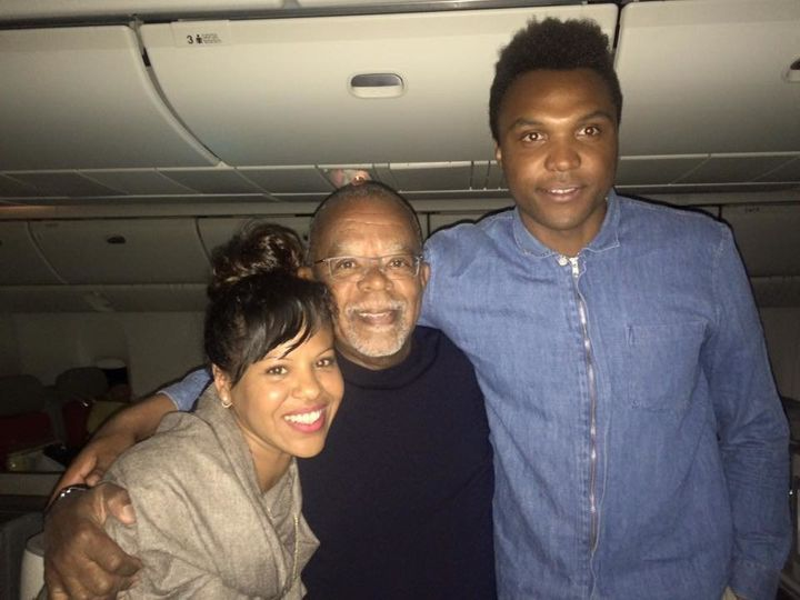 Maria V. Luna and her husband with historian Henry Louis Gates Jr. (middle) on a flight back from South Africa in 2016.