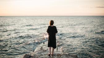 Young Caucasian Woman walking  near the sea