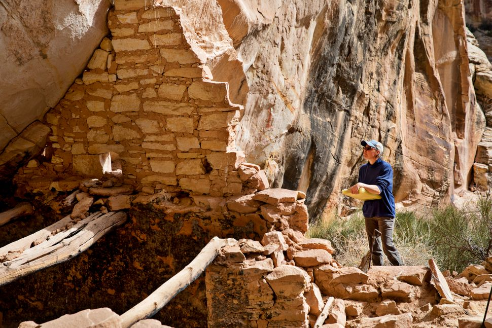 Shanna Diederichs, an architectural conservator, examines a ruin in Bears Ears National Monument and documents its
