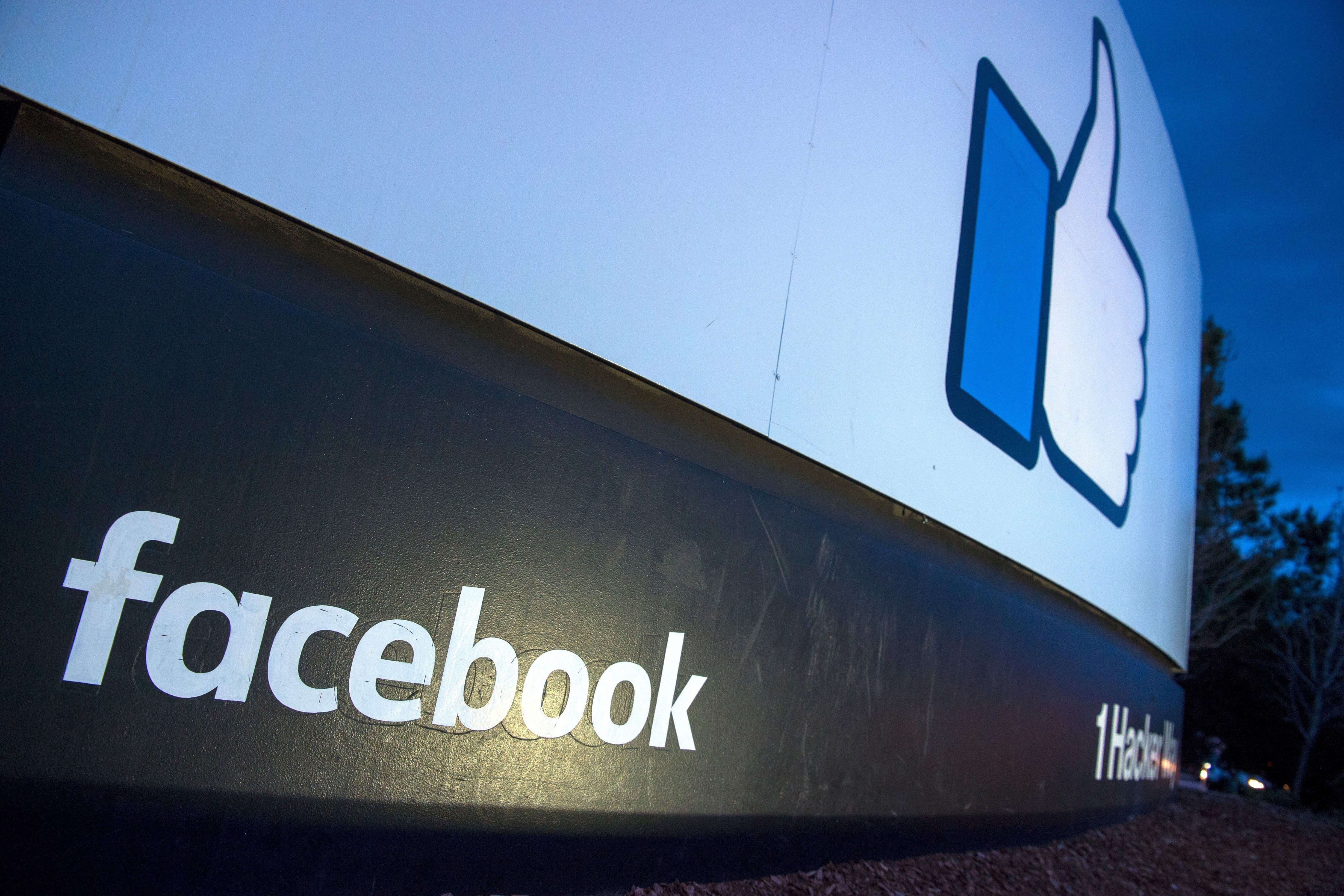 A lit sign is seen at the entrance to Facebook's corporate headquarters location in Menlo Park, California on March 21, 2018.  Facebook chief Mark Zuckerberg vowed on March 21 to 'step up' to fix problems at the social media giant, as it fights a snowballing scandal over the hijacking of personal data from millions of its users. / AFP PHOTO / JOSH EDELSON        (Photo credit should read JOSH EDELSON/AFP/Getty Images)