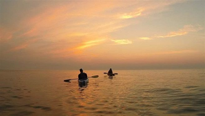 Kayakers paddle on Lake Michigan. A proposed Foxconn electronics plant in Wisconsin would drain 7 million gallons a day from