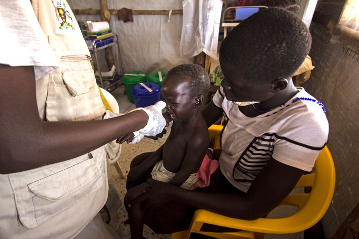 A baby is treated for malaria at a makeshift clinic in the Palabek refugee settlement in northern Uganda.