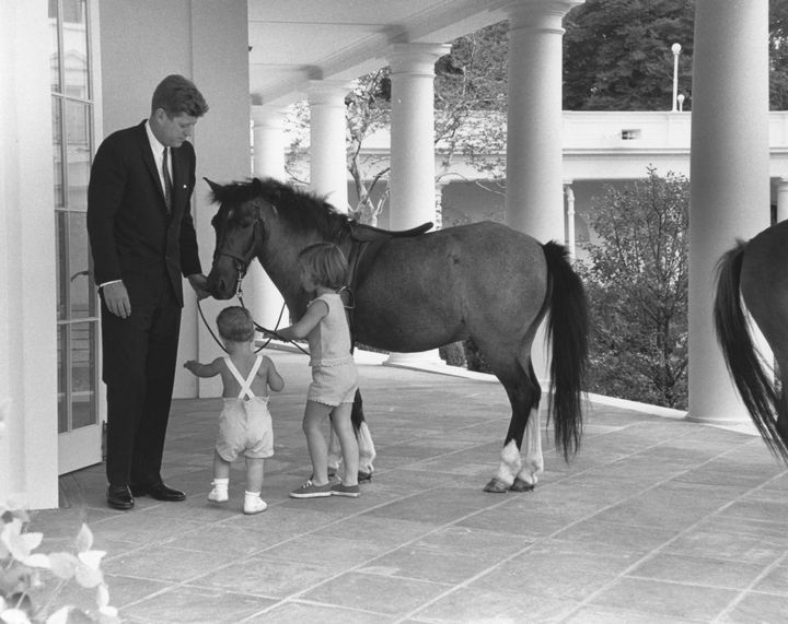 Kennedy with his children and their pony, Macaroni.
