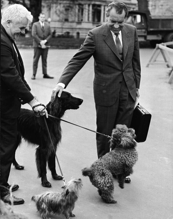 Nixon greets his dogs outside the White House in 1970.